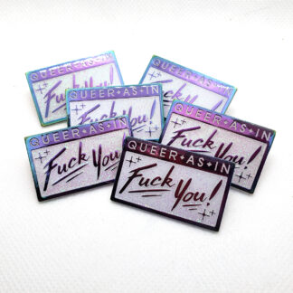 "rectangular pin made of rainbow metal. 'queer as in' is at the top in white enamel. there is a rectangle below with ""Fuck you!"" in rainbow metal. Iridescent glitter covers the white enamel areas."